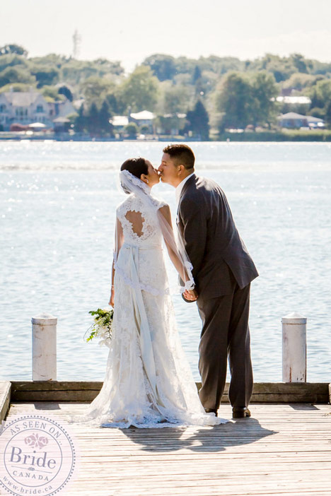 Wedding photos by the lake. Couple kissing