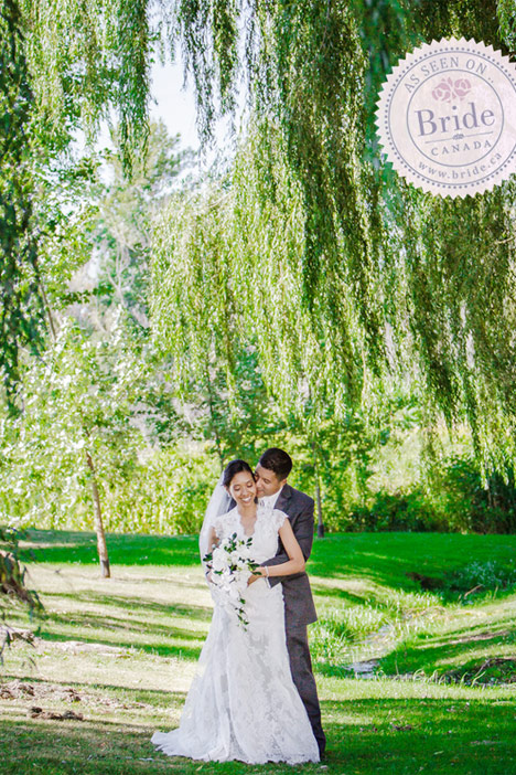 Church ceremony and couples photo beneath elm trees.