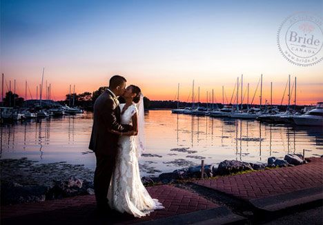 Sunset photo of couple kissing on the shores of Lake Ontario