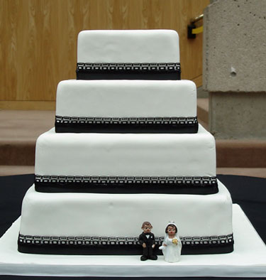 wedding cake topper on the side of the cake!