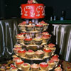 Red fondant cake with Cupcakes