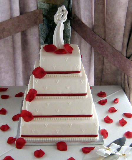 Would you do it for your wedding Four Layer Red Ribbon Rose Petals Cake