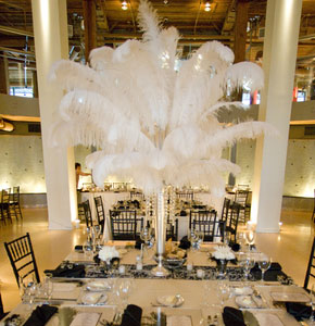 White, ostrich feather wedding centrepiece idea
