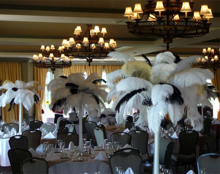 Wedding decor with black & white feather centerpieces