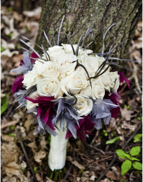 Bridal bouquet with white roses and feathers