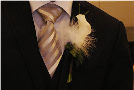 feather + flower groom wedding boutonniere