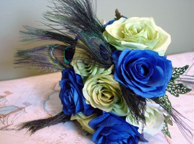 Peacock feather bridal bouquet with blue and white roses