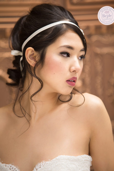 beauty hair and makeup inspiration for a bride. Asian model with ponytail and ribbon in her hair. Soft pink lip and cheeks