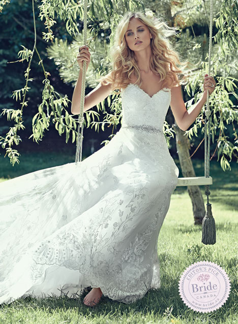 Maggie Sottero Luna aline wedding dress model on wooden swing