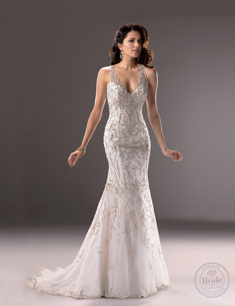Model wearing Maggie Sottero Blakely silver beaded trumpet gown with V-neckline