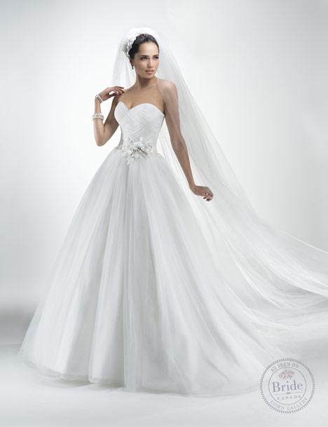 Model wearing Maggie Sottero Tyler. Tulle ballgown with ruched bodice.