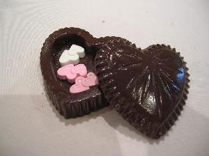 Heart-shaped chocolate wedding favor box, filled with candy
