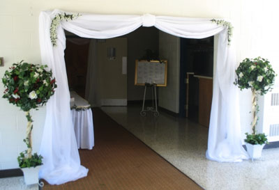 Wedding entrance drape and flowers