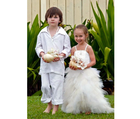 Two children in a wedding outfit