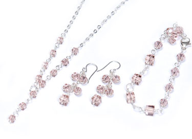 Long, dangling, pink crystal bridal earrings