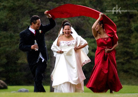 bride and bridal party in the rain!