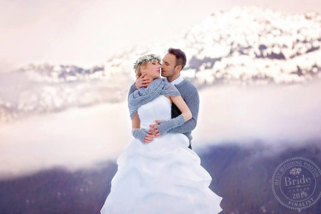 bride and groom kissing in the snowy rocky mountains