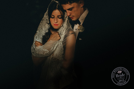 low light wedding photography idea reflective bride and groom with veil wrapped around bride