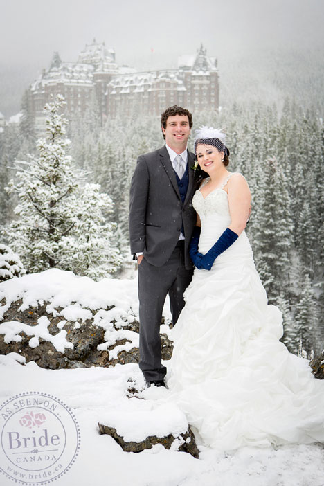 Sardachuk and Petker in front of the gorgeous Banff Springs Fairmont, in winter