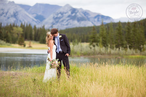 bride and groom at Banff Alberta wedding beside a lake and mountains