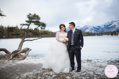 winter wedding setting at a frozen lake with bride and groom in Jasper Alberta