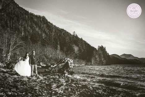 stylized black and white photo of bride and groom on a rocky beach in the mountains of northern BC.