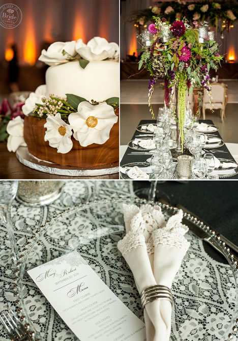 close up of two layer cake, tall floral centrepiece in silver vase and menu with lace napkin