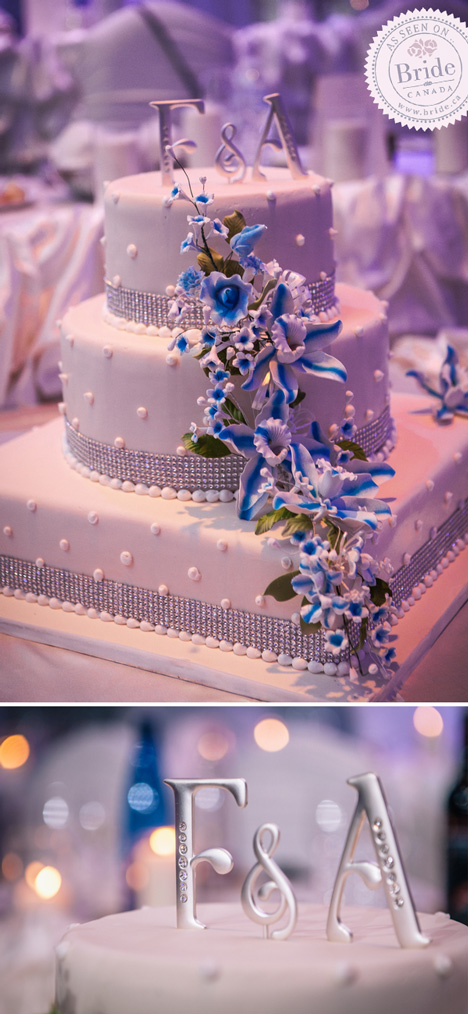 three tier white fondant wedding cake with crystals and white and blue flowers