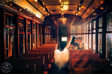 Bride and groom portrait on a train at the Burnaby Village Museum