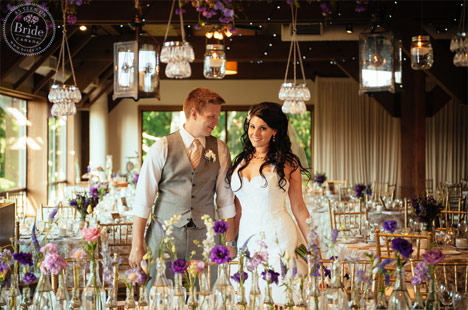 Bride and groom portrait with rustic wedding decor.
