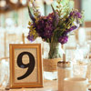 The table numbers were creatively displayed is mis-matched frames.