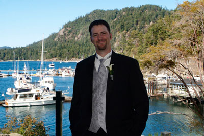 The happy groom, overlooking Poets Cove, on Pender Island