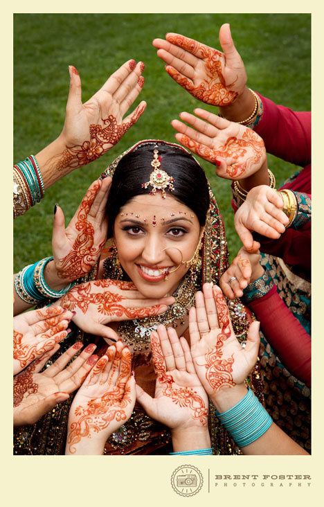 The intricate mehndi designs on the bride's hands