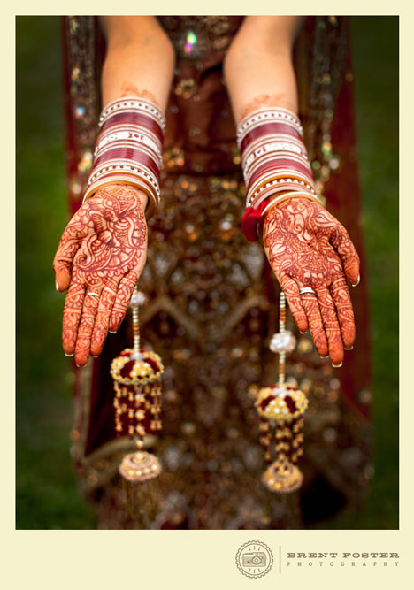 The intricate mehndi designs on the bride's hands and on the hands of the female family members