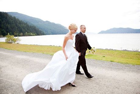The happy wedding couple, walking together by the lake.. an image of romance and togetherness!