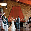 The indoor ceremony location is equally as beautiful, thanks to the rock wall feature and dark wood mantel.