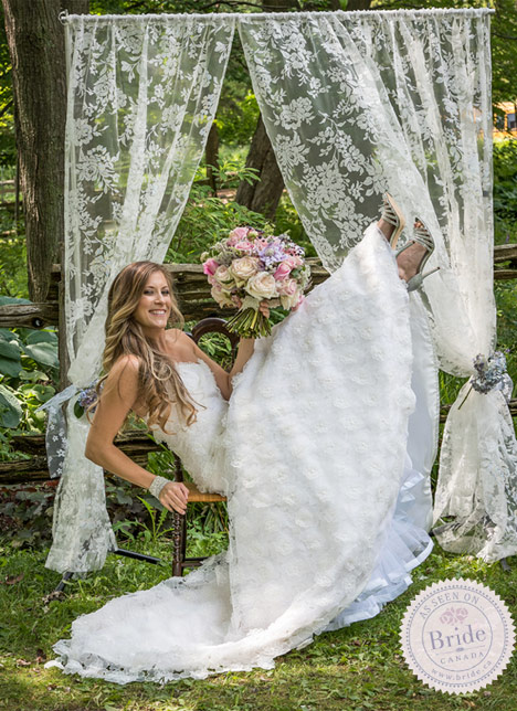 Fun photo shoot with shabby chic decor, lace wedding dress, and lace curtains.