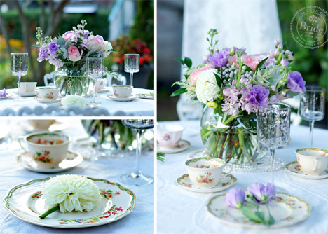 vintage wedding decor with china plate wrought iron chairs and chandeliers