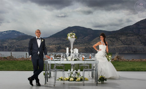 bride and groom at Painted Rock Estate Winery standing with lucite reception table and chairs.
