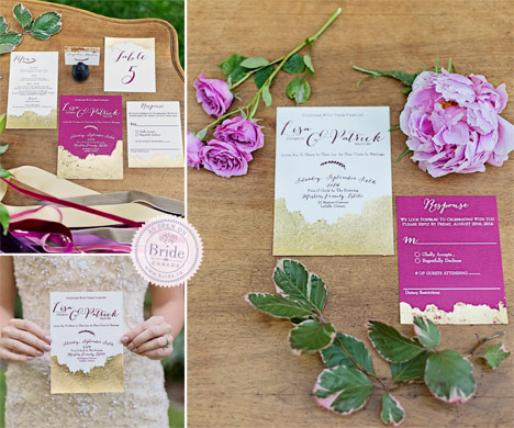 wedding invitation suite with sparkly gold and pink displayed with roses on table