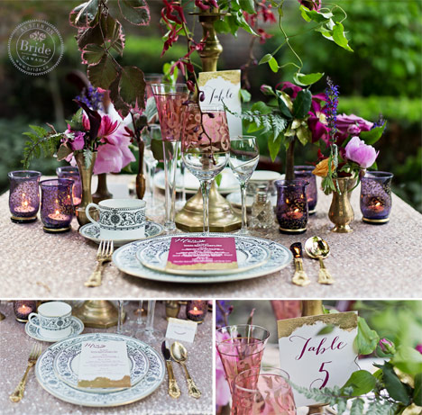 wedding tablescape with vibrant pink and magenta flowers, purple votives, gold cutlery, and blue china.