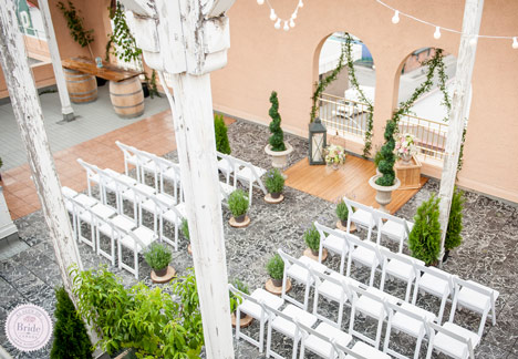 Tuscan theme rooftop ceremony with white chairs in the Okanagan at The Plaza Hotel Kamloops