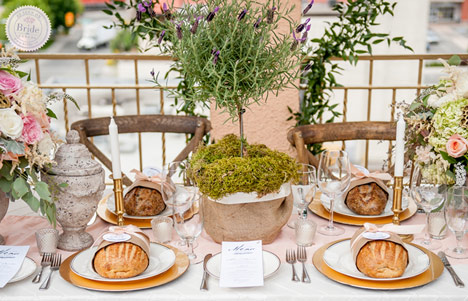 Tuscan Theme Wedding Reception Ideas With Bread Favours And Pastel Florals.