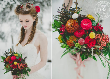 Bride with braids holding a rich holiday inspired bouquet.
