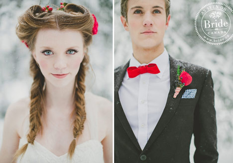 winter bride with two braids and red berries in hair and pink lip. Groom in grey suit with red bow tie.