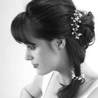 Very interesting bridal hairstyle: ponytail with a hair vine