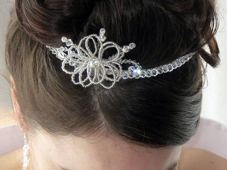 http://www.bride.ca/wedding-ideas/images/Blog/WeddingHair/Tiara/SilverFlowerTiara.jpg
