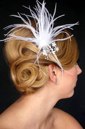 hair with feathers. With a chignon, a knot of hair