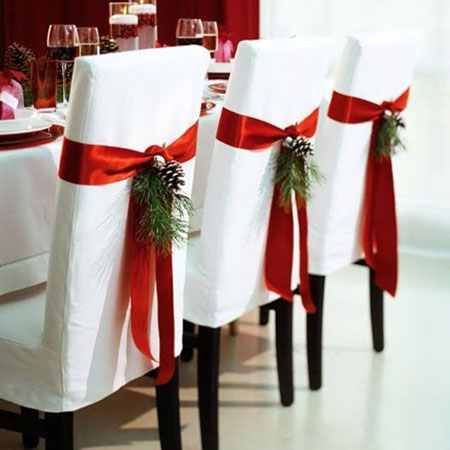 Red Ribon chair decor for a winter wedding theme
