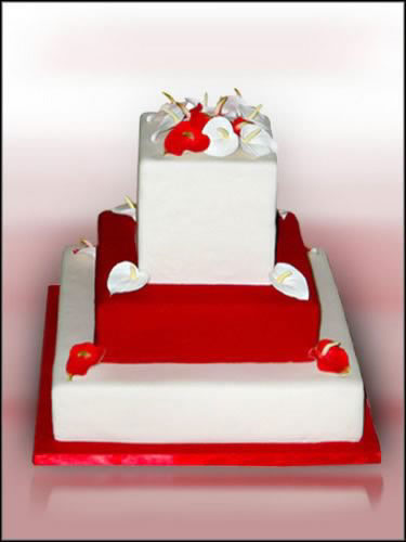 This beautiful red and white wedding cake is from Just Temptations in